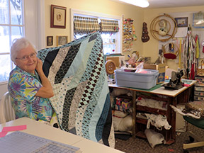 Doris with a quilt cupboard quilt